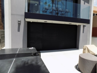 Beach House Motorized Power Screen in Newport Beach